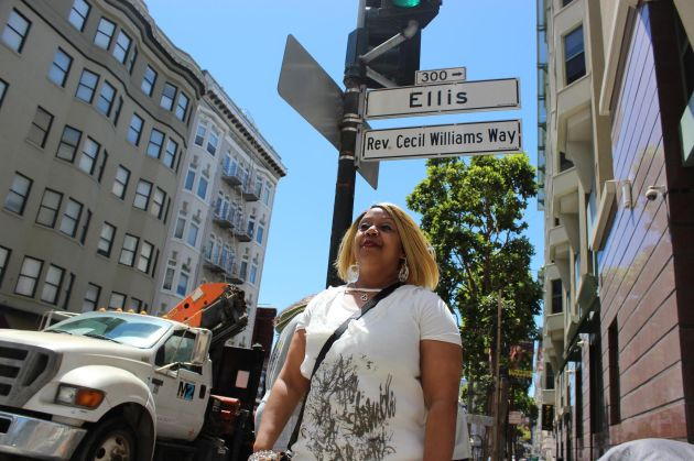 Yolanda Morrissette stands on Rev. Cecil Williams Way, a street named after Glide's co-founder.