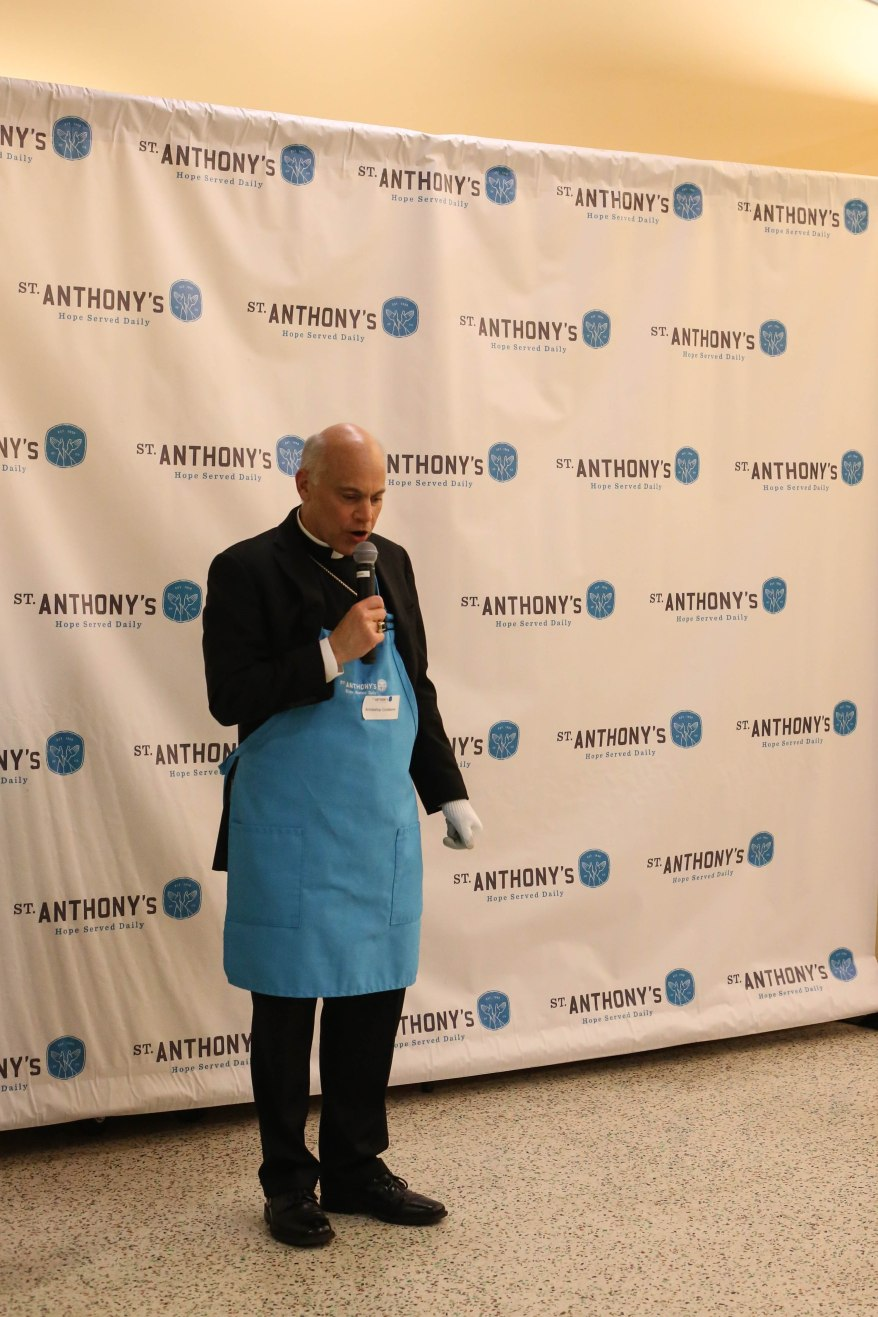 Salvatore Cordileone, Archbishop of San Francisco, says a blessing for the food that is being prepared at St. Anthony's for Thanksgiving Day in San Francisco on Wednesday, November 23, 2016.